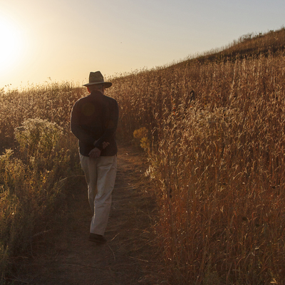 A visitor enjoys the Park's tallgrass prairie in the fall