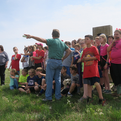 Prairie Guard Dan Wagner tells the stories of Mount Mitchell to schoolchildren